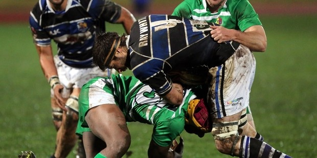 GOING LOW: Lock Sonny Woodmass gets on top of his opposite Mike Baker at Cooks Gardens last night.